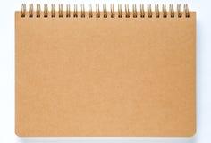 Brunt anteckningsbokpapper på vit bakgrund Royaltyfria Foton
