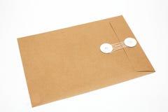 brunt kuvert isolerad white Fotografering för Bildbyråer