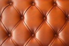 Brunt läder av soffatextur Fotografering för Bildbyråer