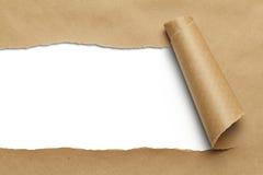 Brunt sönderrivet papper Arkivbild