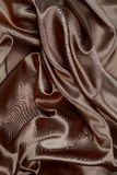 Brunt siden- material eller elegant tapet de för textursatängsammet Royaltyfria Bilder
