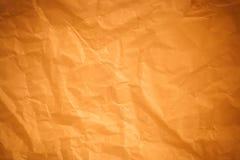 Brunt skrynklig pappers- bakgrund royaltyfri fotografi