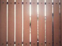 Brunt staket som göras från trä Arkivfoto