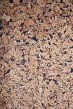Brunt texturerade korkbrädebakgrund arkivbilder