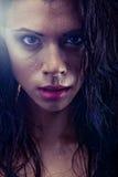 Bruntette wet woman portrait. Sexy bruntette wet woman portrait Stock Images