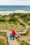 Family walking down walkway on Bruny island neck. Bruny Island Neck, Tasmania, Australia - December 20, 2016: family walking down walkway on Bruny island neck stock photos