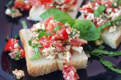 Bruscetta with tomatoes and cheese Stock Photos