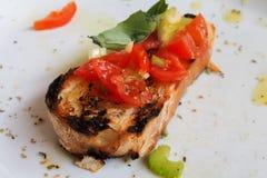 Bruscettabrood met tomaten Royalty-vrije Stock Afbeeldingen