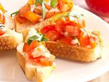 Bruschetta από τις ντομάτες και Ruccola Στοκ φωτογραφία με δικαίωμα ελεύθερης χρήσης