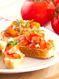 Bruschetta από τις ντομάτες και Ruccola Στοκ εικόνες με δικαίωμα ελεύθερης χρήσης