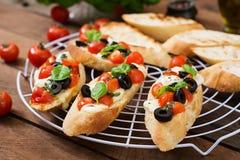 Bruschetta с томатами, моццарелла Стоковая Фотография