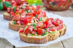 Bruschetta с томатами, травами и маслом Стоковые Фото