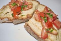 Bruschetta с томатами Стоковые Изображения