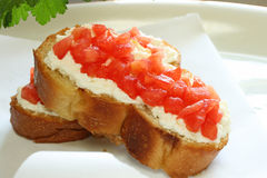 Bruschetta. With ricotta and tomatoes on parchment paper wrap Royalty Free Stock Photo