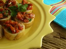 Bruschetta. Appetizer on a sun-shaped plate Royalty Free Stock Photo