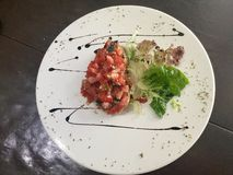 Tomato Bruschetta with lettuce and balsami - top overview. Bruschetta is an antipasto & x28;starter dish& x29; from Italy consisting of grilled bread rubbed with Stock Photography