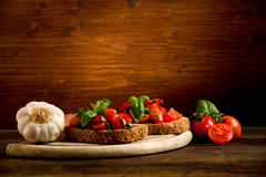 Bruschetta appetizer with fresh tomatoes Royalty Free Stock Images