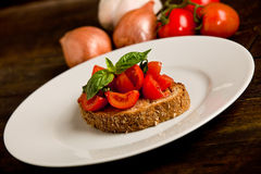 Bruschetta appetizer with fresh tomatoes Royalty Free Stock Photography