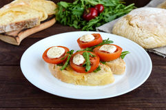 Bruschetta with arugula, tomatoes, mozzarella, olive oil on slices of chiabatta. Light breakfast stock photos