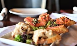 Fine dining bruschetta assortment appetizer royalty free stock images