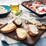Bruschetta with Baked tomato and garlic close up Stock Images