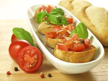 Bruschetta with basil leaf Royalty Free Stock Photo