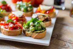 Bruschetta with beans and arugula, mushrooms, goat cheese Royalty Free Stock Photos