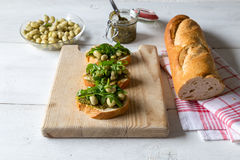 Bruschetta with beans and rocket Stock Image