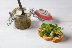 Bruschetta with beans and rocket Stock Photos