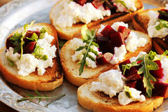 Bruschetta with beet, feta and ruccola Royalty Free Stock Image