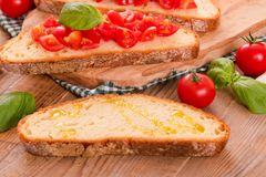 Bruschetta bread with basil and chopped tomatoes. Stock Images