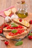 Bruschetta bread with basil and chopped tomatoes. Royalty Free Stock Photography