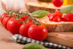 Bruschetta bread with basil and chopped tomatoes. Stock Image
