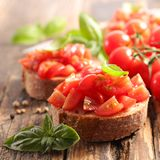 Bruschetta. With tomato and basil Stock Photo
