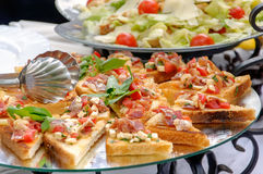 Bruschetta and Caesar salad Royalty Free Stock Photos