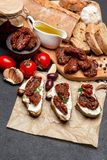 Bruschetta with Canned Sundried or dried tomato halves on craft pepper. Bruschetta with Canned Sundried or dried tomato halves and cream cheese on craft pepper Stock Photography
