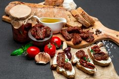 Bruschetta with Canned Sundried or dried tomato halves on craft pepper. Bruschetta with Canned Sundried or dried tomato halves and cream cheese on craft pepper Stock Image