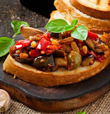 Bruschetta caponata with raisins and pine nuts Stock Photography