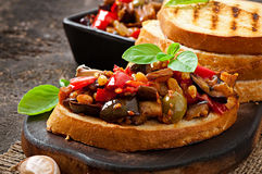 Bruschetta caponata with raisins and pine nuts Stock Photo
