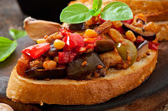 Bruschetta caponata with raisins and pine nuts Royalty Free Stock Image