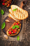 Bruschetta caponata with raisins and pine nuts Royalty Free Stock Photography