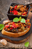 Bruschetta caponata with raisins and pine nuts Stock Images
