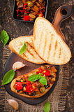 Bruschetta caponata with raisins and pine nuts Stock Photos