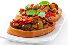 Bruschetta caponata with raisins and pine nuts Royalty Free Stock Images
