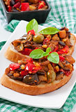 Bruschetta caponata with raisins and pine nuts Royalty Free Stock Photo