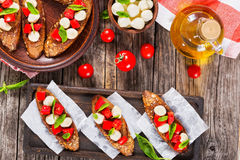 Bruschetta  with caprese salad on rye baguette, close-up Royalty Free Stock Photos