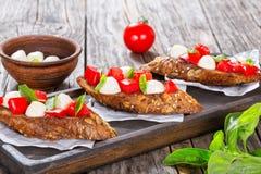 Bruschetta with caprese salad on rye baguette Stock Photo