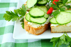 Bruschetta with cheese and fresh cucumber Royalty Free Stock Image