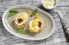 Bruschetta with cheese, pear, honey and nuts on the oval plate Royalty Free Stock Photo