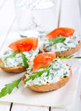Bruschetta with cheese and rocket spread Royalty Free Stock Photos